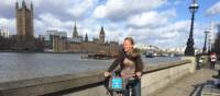 Cycling along the Thames Path in London with Big Ben and the Houses of Parliament in the background | Kate Baker