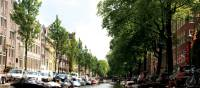 Views down the beautiful canals in Amsterdam | Nick Kostos