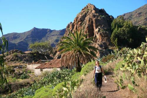 A hiker walking through Benchijigua in Gomera